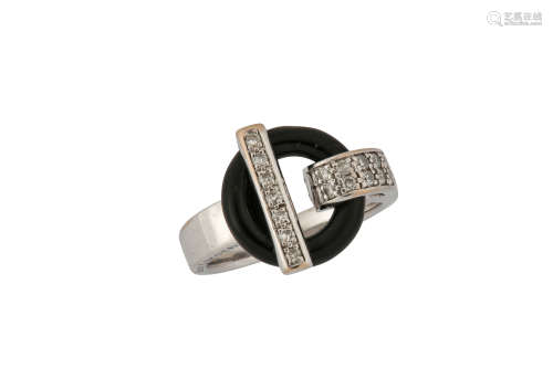 An onyx and diamond ring, by Guy Laroche