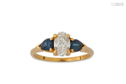 A sapphire and diamond three-stone ring