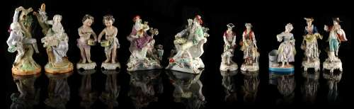 Property of a gentleman - a pair of 19th century Samson Chelsea style figural candlesticks, gold