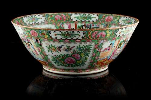 An early 20th century Chinese Canton famille rose medallion bowl, three rim chips with associated