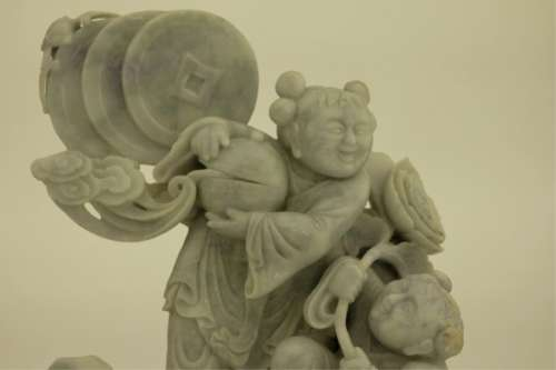 A Large Jadeite with Carved Kids and Coins