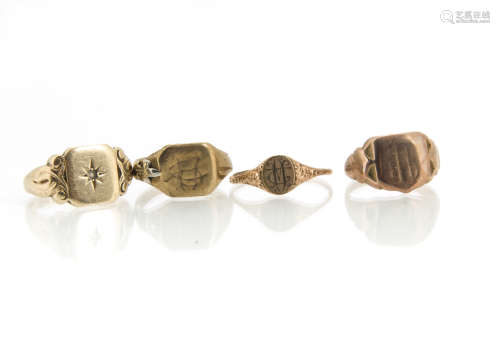 Four 9ct gold signet rings, one with gypsy paste stone setting, another with engraved shoulders, 17g