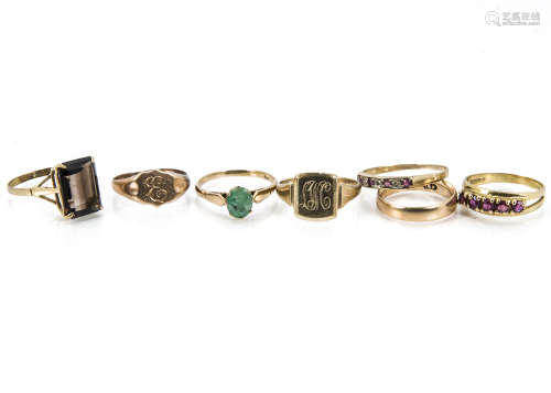 Seven 20th century gold rings, including a 14ct gold wedding band, two 9ct gold signet rings, and