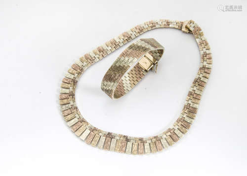 A 1970s tri colour 9ct gold Cleopatra style fringe necklace, and matching tri colour bracelet, total