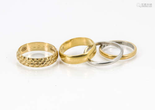 Four Art Deco and later wedding bands, one plain 22ct gold example, 4.5g, an engraved 18ct gold