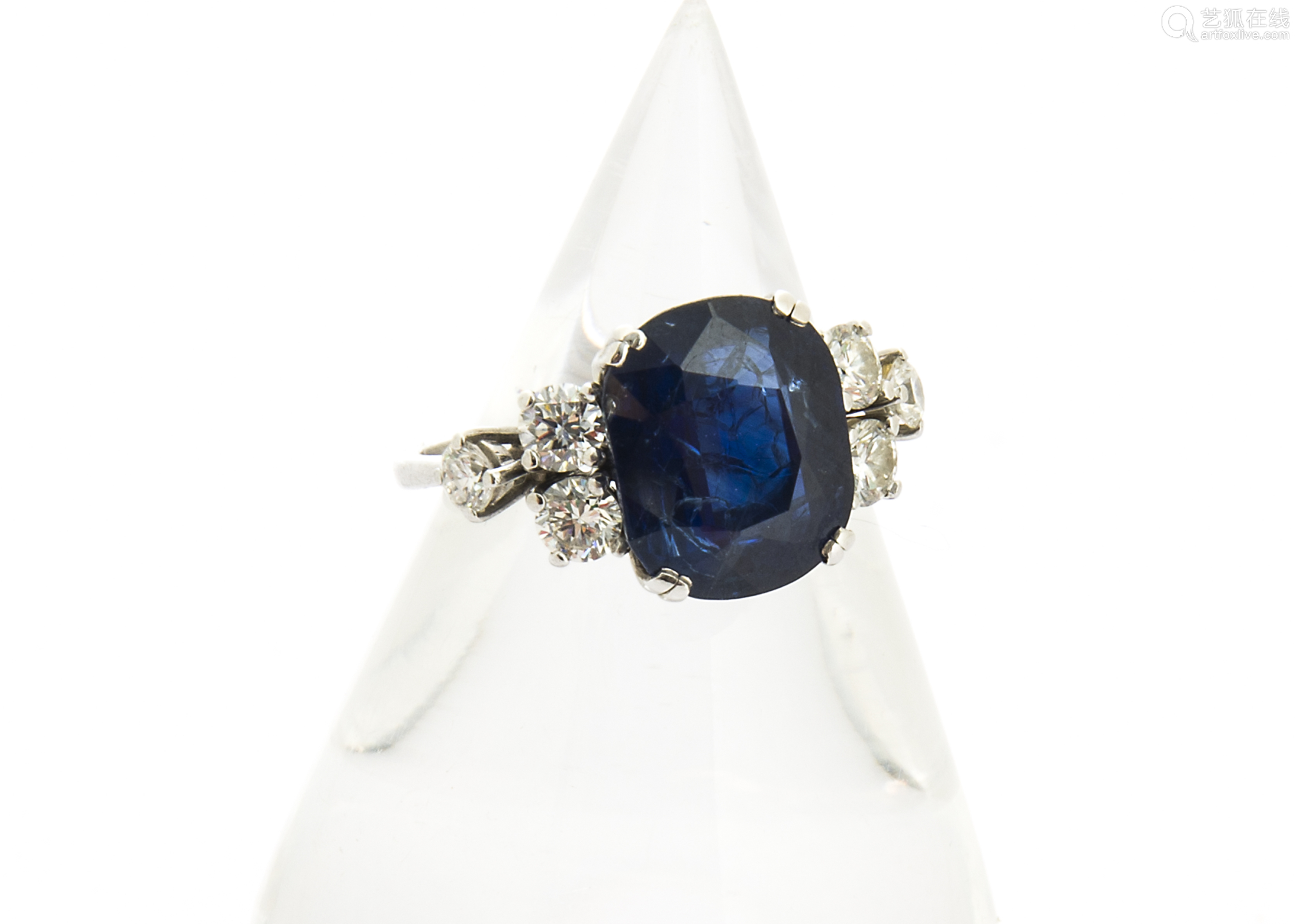 A sapphire and diamond 18ct gold dress ring, the oval mixed cut sapphire in four claw setting set