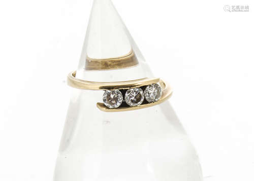 A three stone diamond crossover dress ring, the 0.75ct diamonds in channel setting, total diamond