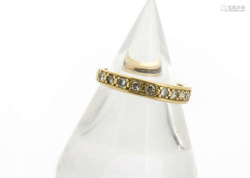 An 18ct gold half hoop diamond set eternity ring, the ten brilliant cuts in channel setting all in