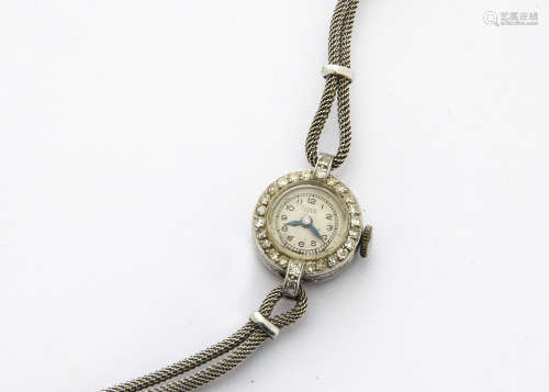 A c1950s Tudor platinum lady's cocktail dress wristwatch, 17mm case set with clear stones to the