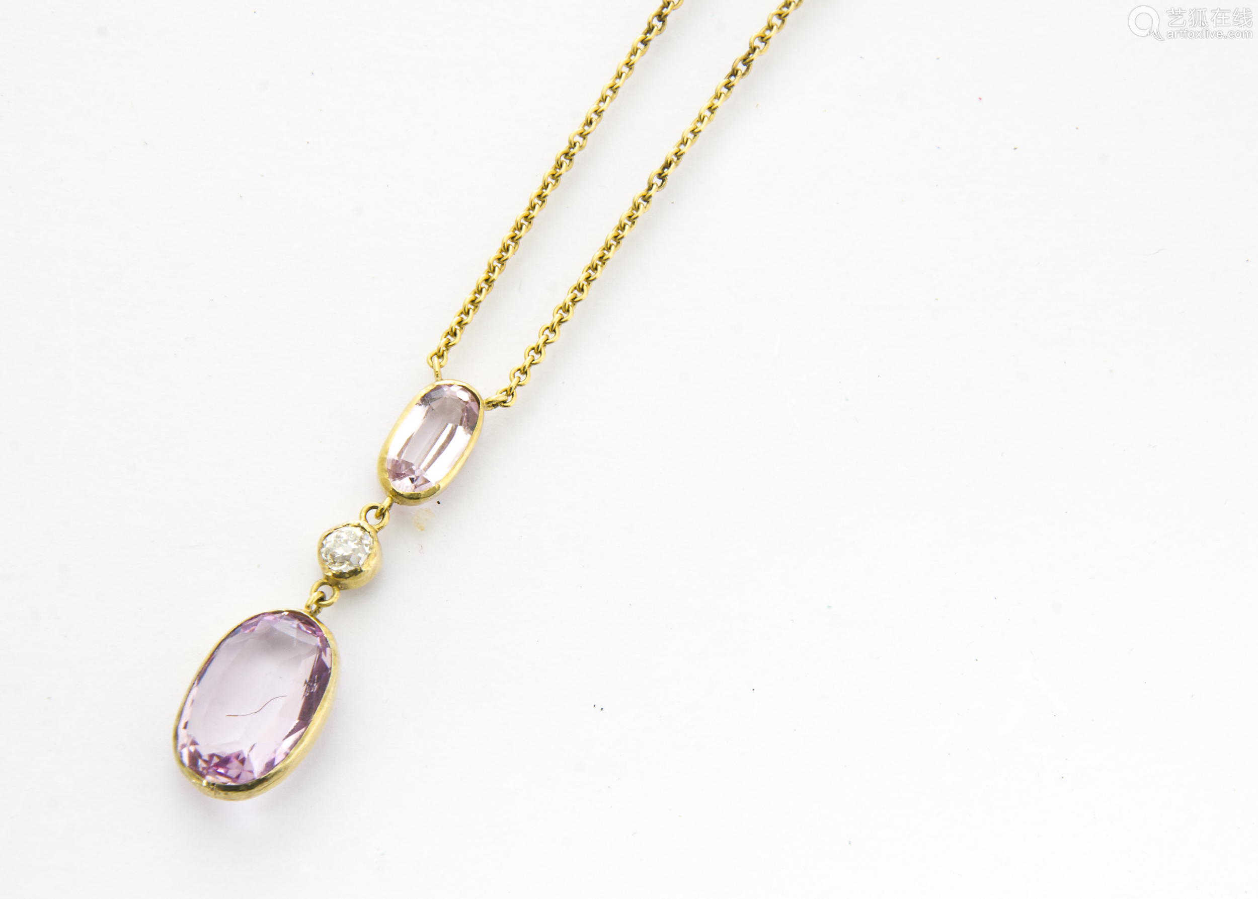 An Edwardian topaz and diamond drop pendant, the two oval pink mixed cut topaz stones in colette