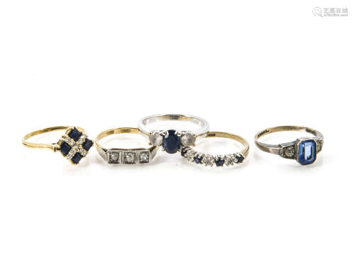 Five gold rings, one white metal with three stones marked 14k, a sapphire and diamond example, an