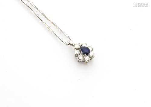 A contemporary sapphire and diamond drop pendant, mixed pear cut sapphire surrounded by claw set