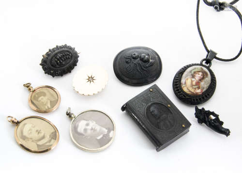 A small collection of mourning jewellery, to include a jet oval locket with porcelain mount, a bog