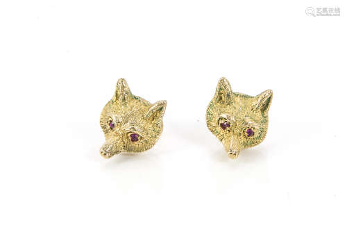 A pair of 1970s 9ct gold earrings, modelled as fox masks each with red stone eyes, 6.2g (2)