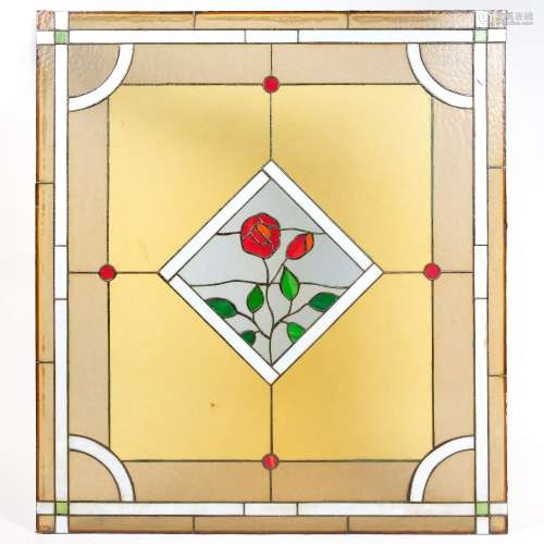 Leaded glass panel 20th Century, decorated with a central plaque depicting a flower, 90cm x 100cm