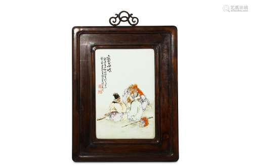 A CHINESE FAMILLE ROSE PORCELAIN PANEL. Painted with four sages in a landscape, inscribed and