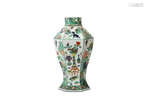 A CHINESE FAMILLE VERTE HEXAGONAL VASE. Qing Dynasty, Kangxi period. Of hexagonal baluster form,