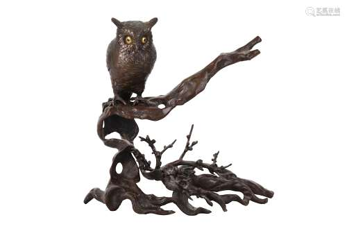 A BRONZE OKIMONO OF AN OWL. 19th Century An owl perched on a gnarled plum tree, the eyes in gilt