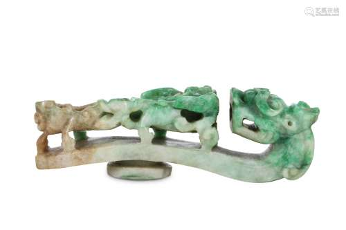 A CHINESE JADEITE 'DRAGON' BELT HOOK. Qing Dynasty. The tip carved as a dragon head, the body with a