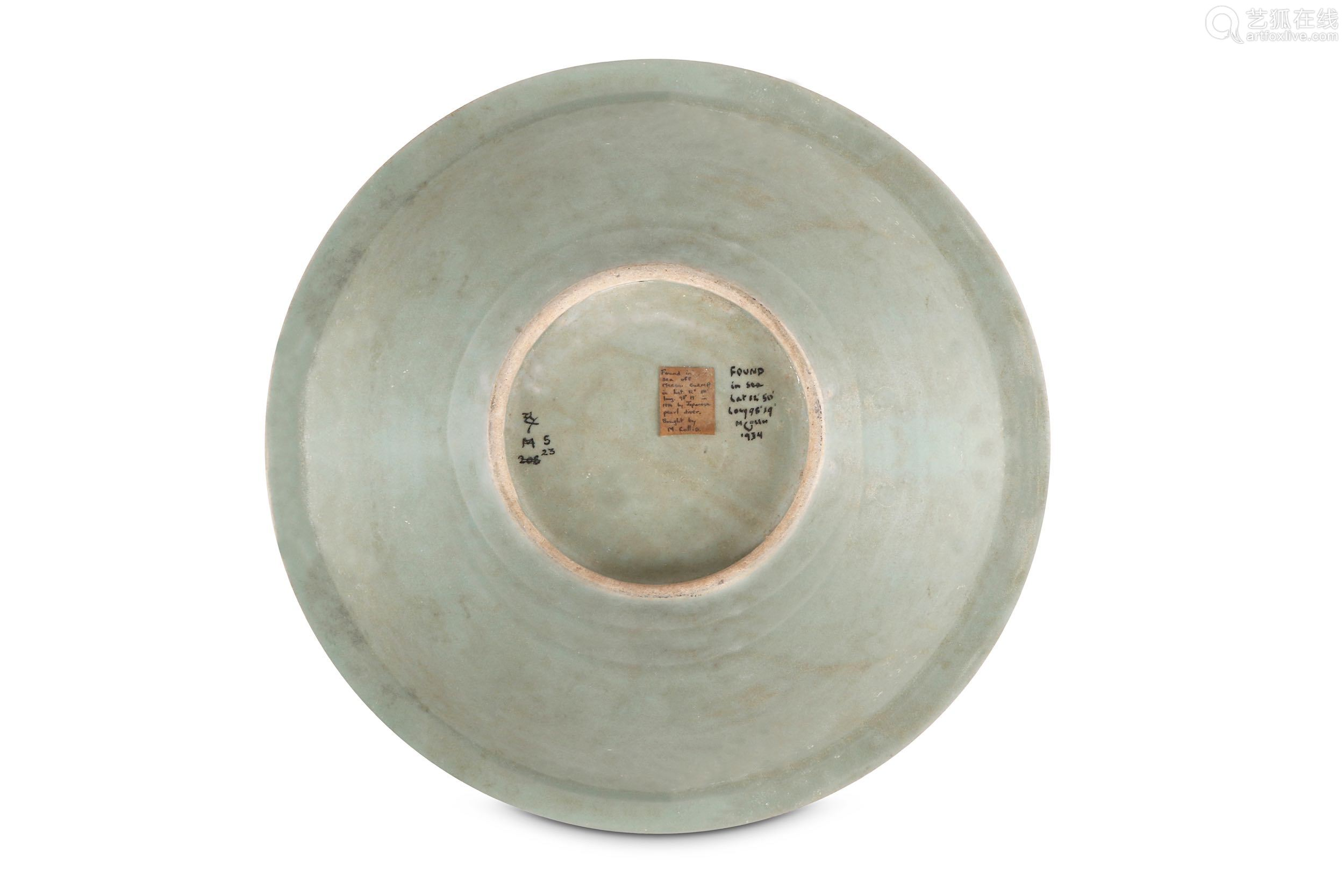 A CHINESE LONGQUAN CELADON CHARGER. Late Ming Dynasty. Incised with a lotus spray to the centre