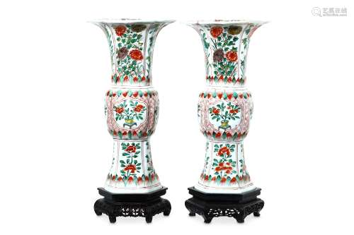 A PAIR OF CHINESE FAMILLE VERTE VASES,GU. Qing Dynasty, Kangxi period. Each with a moulded body