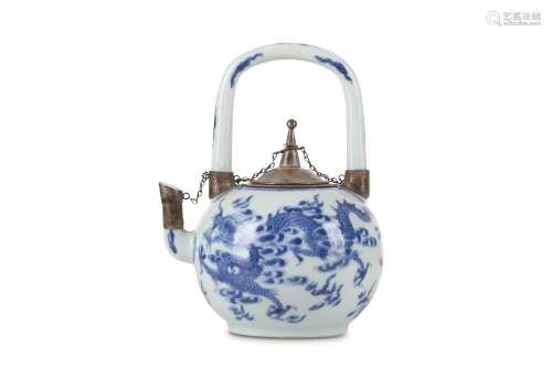 A CHINESE BLUE AND WHITE 'DRAGON' TEAPOT AND COVER. Qing Dynasty, 18th Century. The ovoid body