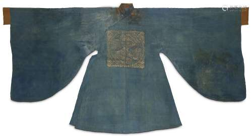 A CHINESE BLUE SILK ROBE. Yuan to early Ming Dynasty. The gown with a rank badge to the centre woven