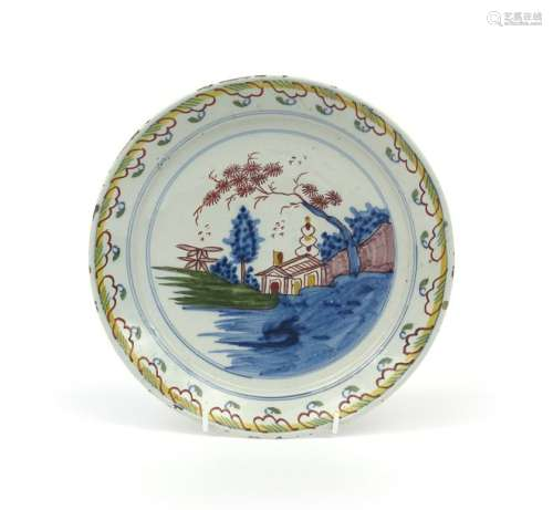 A Brislington delftware plate c.1710 20, painted i...;