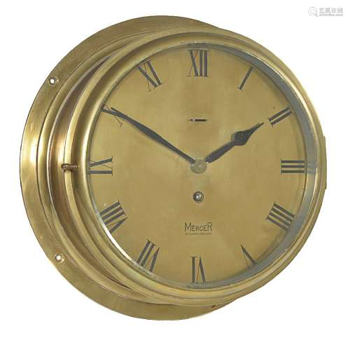 A brass ship's bulkhead timepiece