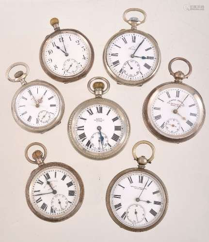 A collection of seven white metal pocket watches