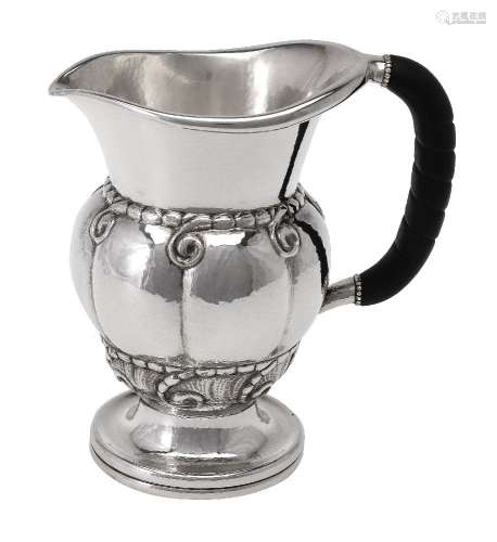 ϒ Georg Jensen, a Danish silver water jug or pitcher