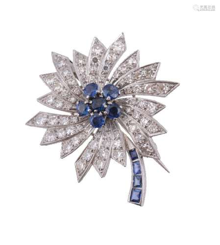 A sapphire and diamond cornflower brooch
