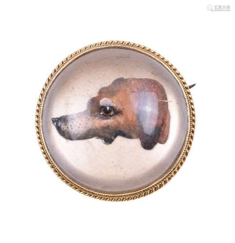 An early 20th century reverse painted crystal intaglio of a hound
