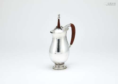 ϒ Georg Jensen, a Danish silver baluster chocolate pot or pitcher