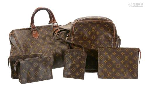 A collection of Louis Vuitton travel bags