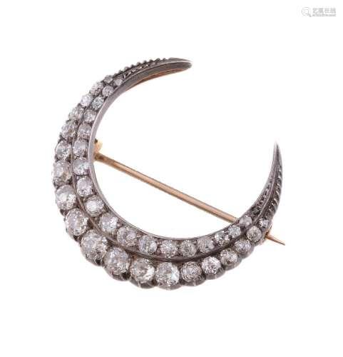 A Victorian diamond crescent brooch