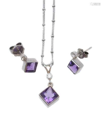 An amethyst and diamond pendant and ear studs