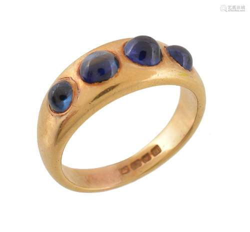 A cabochon sapphire four stone ring