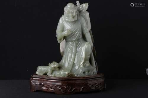 A JADE CARVED FIGURE OF BUDDHA