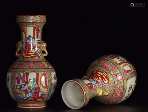 A PAIR OF STORY DESIGN DOUBLE-EAR VASES