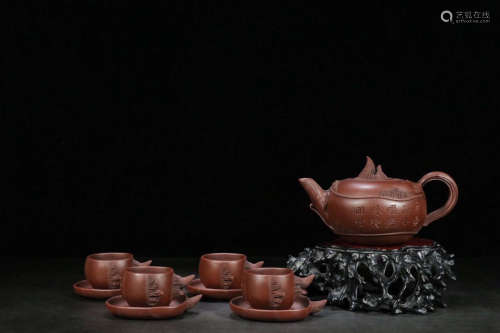 A FLORAL AND VERSE PATTERN CLAY TEAPOT SET