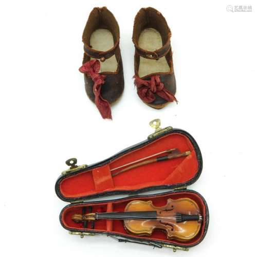 A Pair of Antique Jumeau Shoes and Miniature Violin