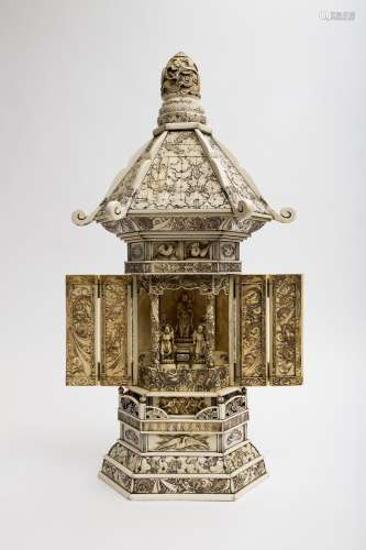 Large, temple-shaped zushi Ivory, with a hexagonal base and a pattern of dragons, lotus leaves and