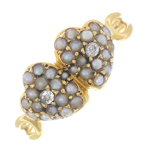 An early 20th century 18ct gold seed pearl and diamond ring.