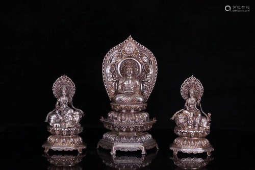SET OF THREE SILVER MOLDED BUDDHA STATUES