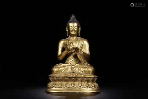 A GILT BRONZE CASTED SHIKYAMUNI BUDDHA