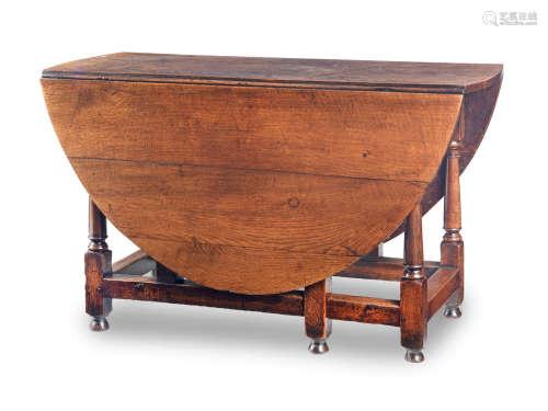 An early 18th century joined oak gateleg table, English, circa 1730