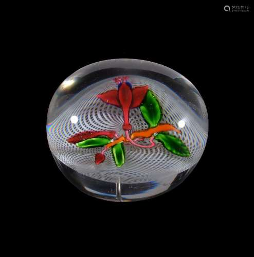 A St. Louis glass 'Fuchia' paperweight, 19th century, the clear glass set with a fuchia flower and a