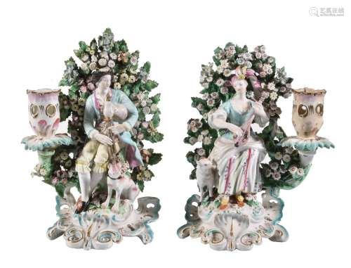 A pair of Derby porcelain figural candlesticks of a shepherd and companion, circa 1770, modelled