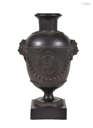 A Humphrey Palmer black basalt vase, circa 1775, the domed shoulder with dentil border suspending